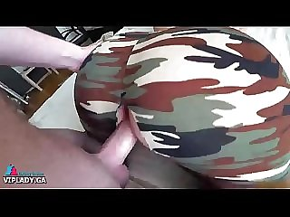 Military husband blows on his beloved little wife in torn camouflage pants